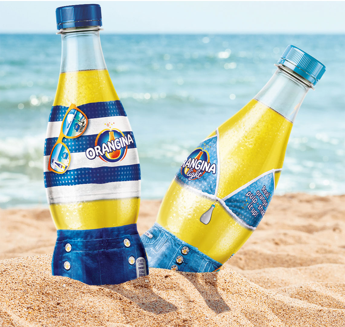 Orangina Bottles In Sand